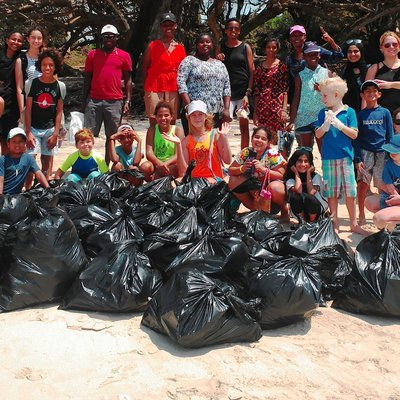 Children and staff keeping the beach clean